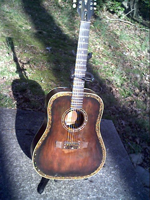 image title is /guitars/Gibson 12-string front view After Bridgeplate repair 2