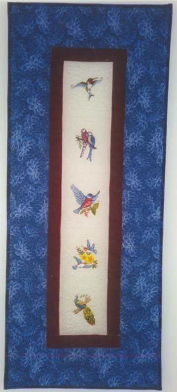 image title is Feathered Friends, Machine Embroidery, 1998